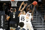 Cincinnati forward Mamoudou Diarra (20) rebounds the ball during the first half of an NCAA college basketball game against Vanderbilt on Thursday, March 4, 2021, in Cincinnati. (Kareem Elgazzar/The Cincinnati Enquirer via AP)