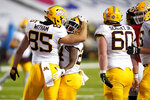 Minnesota tight end Bryce Witham, left, congratulates running back Mohamed Ibrahim after he scored a touchdown run against Maryland during the first half of an NCAA college football game, Friday, Oct. 30, 2020, in College Park, Md. (AP Photo/Julio Cortez)