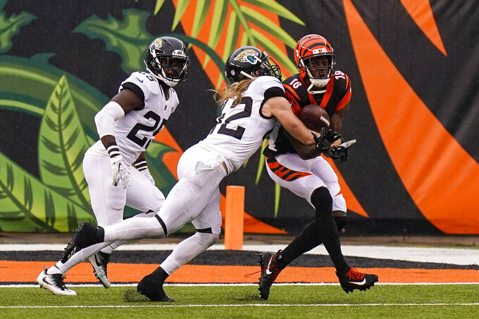 Jacksonville Jaguars free safety Andrew Wingard (42) breaks up a pass to Cincinnati Bengals wide receiver A.J. Green (18) in the second half of an NFL football game in Cincinnati, Sunday, Oct. 4, 2020. (AP Photo/Bryan Woolston)