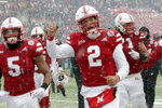 Nebraska quarterback Adrian Martinez (2) celebrates in the snow following an NCAA college football game against Michigan State in Lincoln, Neb., Saturday, Nov. 17, 2018. Nebraska won 9-6. (AP Photo/Nati Harnik)