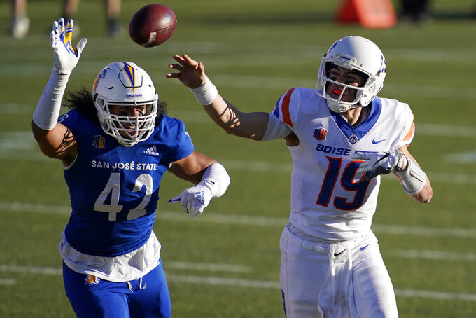 Boise State quarterback Hank Bachmeier (19) throws against San Jose State defensive end Viliami Fehoko (42) during the first half of an NCAA college football game for the Mountain West championship, Saturday, Dec. 19, 2020, in Las Vegas. (AP Photo/John Locher)