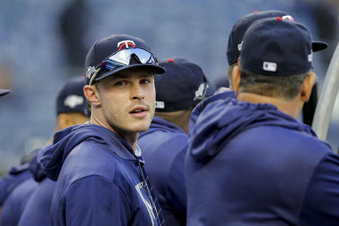 """FILE - In this Oct. 4, 2019, file photo, Minnesota Twins' Max Kepler waits to take batting practice before Game 1 of an American League Division Series baseball game against the New York Yankees in New York. Twins right fielder Max Kepler didn't get to watch a lot of major league baseball growing up in Germany. The games he did did see included many Boston Red Sox-New York Yankees matchups, which caused him to become a big fan of Derek Jeter. """"I loved watching Jeter, even though I'm a lefty and the complete opposite of what he was,"""" Kepler said Tuesday, Feb. 18, 2020, before Minnesota's second full-squad workout. """"He was the guy I really looked up to."""" (AP Photo/Seth Wenig, File)"""