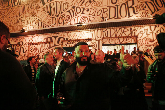 In this Tuesday, Dec. 3, 2019, photo, DJ Khaled gives a thumbs up after the Christian Dior pre-fall 2020 men's fashion show during Miami Art week, in Miami. (AP Photo/Brynn Anderson)