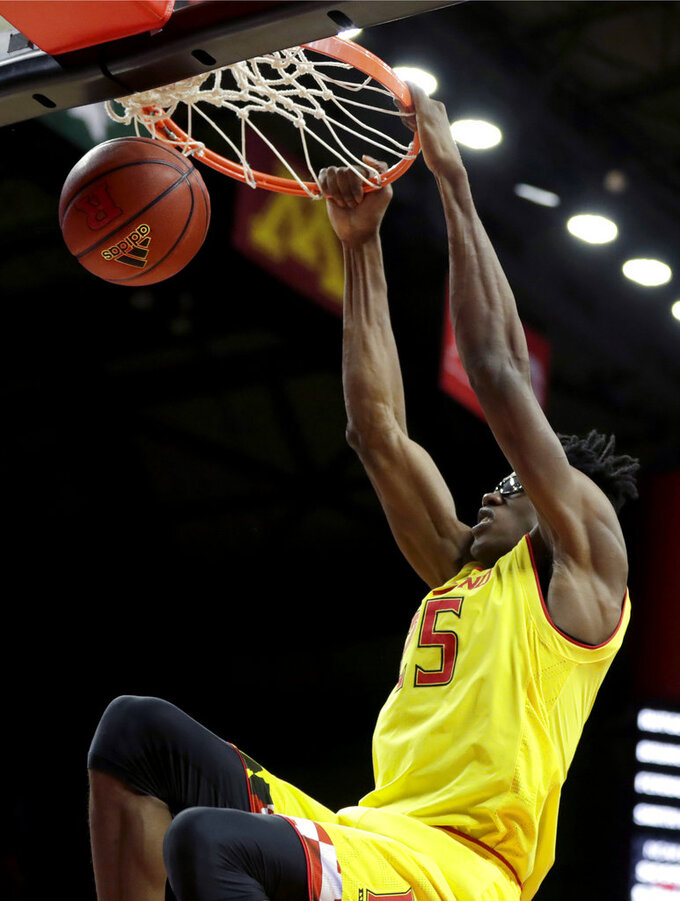 Maryland forward Jalen Smith dunks on Rutgers during the first half of an NCAA college basketball game, Saturday, Jan. 5, 2019, in Piscataway, N.J. (AP Photo/Julio Cortez)