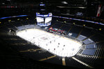 The Tampa Bay Lightning and the Columbus Blue Jackets play in an arena empty of fans during the first period of an NHL hockey game Thursday, Jan. 21, 2021, in Columbus, Ohio. (AP Photo/Jay LaPrete)