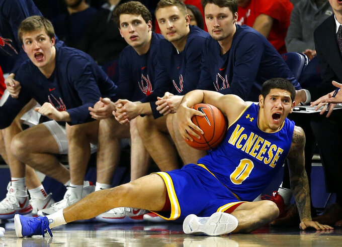 McNeese State's Dru Kuxhausen (0) reacts after being fouled in front of the Richmond bench during the first half of an NCAA college basketball game in Richmond, Va., Friday, Nov. 22, 2019. (Dean Hoffmeyer/Richmond Times-Dispatch via AP)