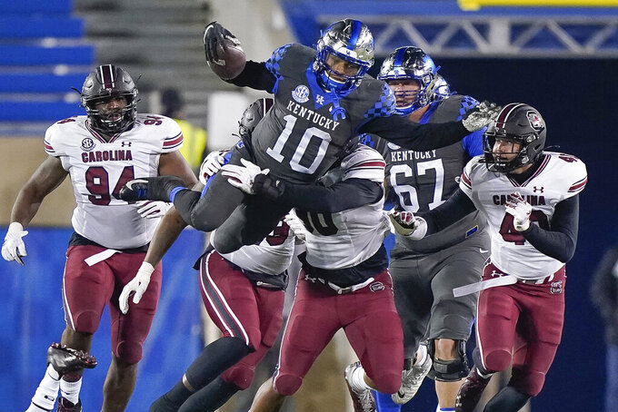 Kentucky running back Asim Rose Jr. (10) leaps at the end of a 15-yard first down run during the second half of an NCAA college football game against South Carolina, Saturday, Dec. 5, 2020, in Lexington, Ky. (AP Photo/Bryan Woolston)