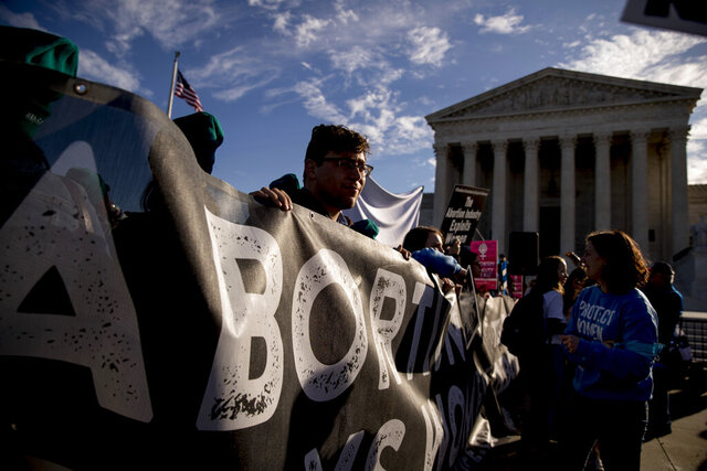 Anti-abortion rights demonstrators rally outside the Supreme Court, in Washington, Wednesday, March 4, 2020, as the court takes up the first major abortion case of the Trump era Wednesday, an election-year look at a Louisiana dispute that could reveal how willing the more conservative court is to roll back abortion rights. (AP Photo/Andrew Harnik)