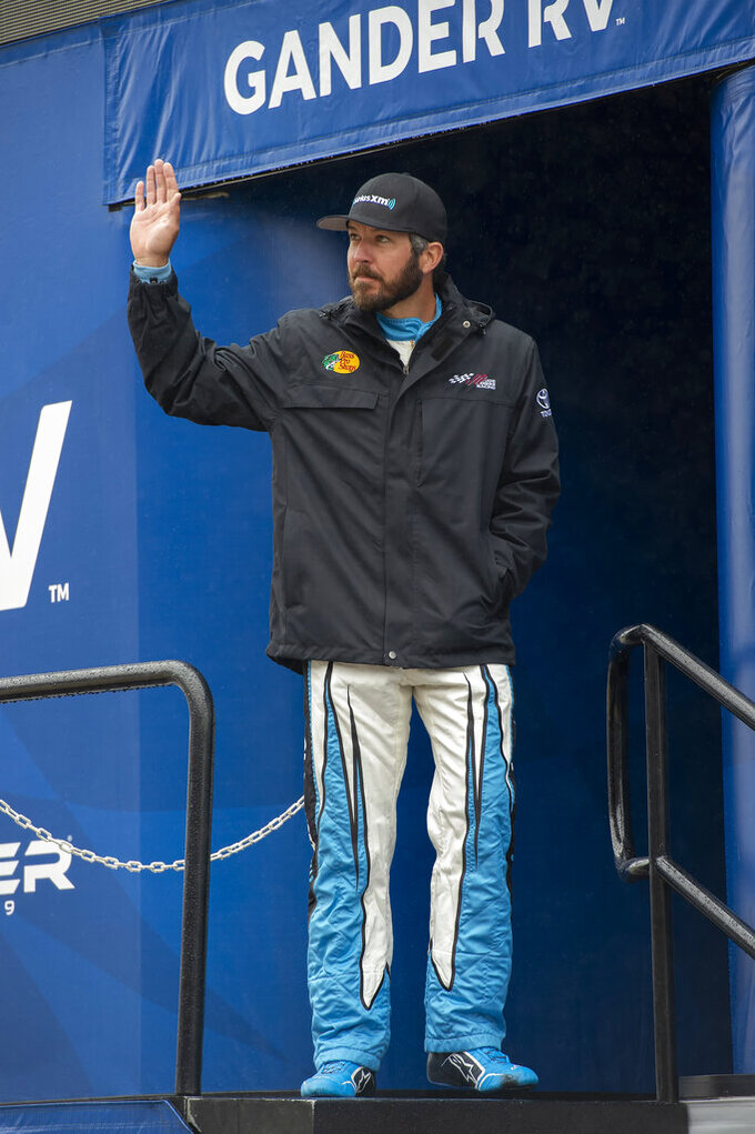 Martin Truex Jr. waves during driver introductions at a NASCAR Cup Series auto race Sunday, May 5, 2019, at Dover International Speedway in Dover, Del. (AP Photo/Jason Minto)