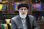 In this Sunday, Sept. 22, 2019 photo, Gulbuddin Hekmatyar, a candidate in Afghanistan's upcoming presidential election, poses for a photo after an interview in his home in Kabul, Afghanistan. While there will be 18 names on the presidential ballot when Afghans go to the polls on Sept. 28 only five, including Hekmatyar, have been campaigning after several suspended their campaigns believing a peace deal with the Taliban was imminent. (AP Photo/Ebrahim Noroozi)