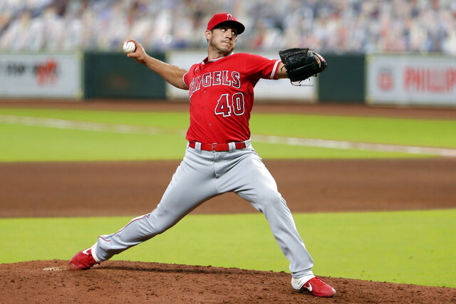 FILE - In this Aug. 24, 2020, file photo, Los Angeles Angels relief pitcher Jacob Barnes throws against the Houston Astros during a baseball game in Houston. Right-hander Barnes and the New York Mets agreed to a $750,000, one-year contract, two days ahead of the deadline for teams to offer 2021 deals to unsigned players on their 40-man rosters. The 30-year-old was 0-2 with a 5.50 ERA for the Angels last season, then was claimed off waivers by the Mets on Oct. 30, 2020. (AP Photo/Michael Wyke, File)
