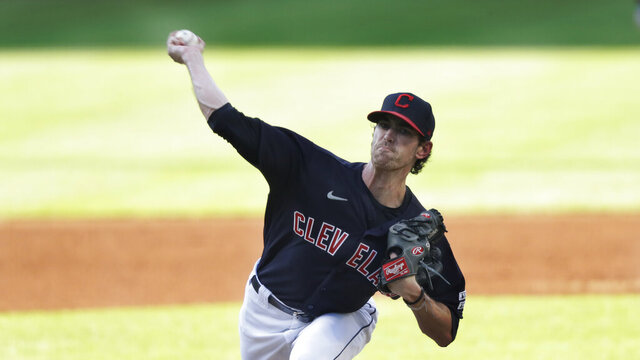 Cleveland Indians starting pitcher Shane Bieber delivers in the first inning in a baseball game against the Kansas City Royals, Friday, July 24, 2020, in Cleveland. (AP Photo/Tony Dejak)