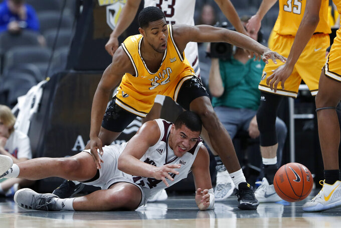 Missouri State's Gaige Prim, bottom, and Valparaiso's Mileek McMillan, top, keep their eyes on a loose ball during the first half of an NCAA college basketball game in the semifinal round of the Missouri Valley Conference men's tournament Saturday, March 7, 2020, in St. Louis. (AP Photo/Jeff Roberson)
