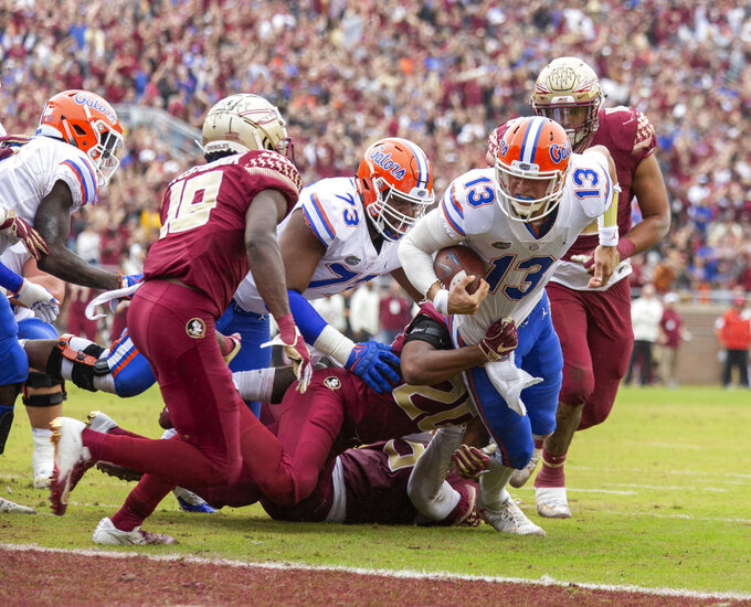 Florida quarterback Feleipe Franks (13) is brought down short of the goal line by Florida State defensive back Jaiden Woodbey (20) in the first half of an NCAA college football game in Tallahassee, Fla., Saturday, Nov. 24, 2018. (AP Photo/Mark Wallheiser)