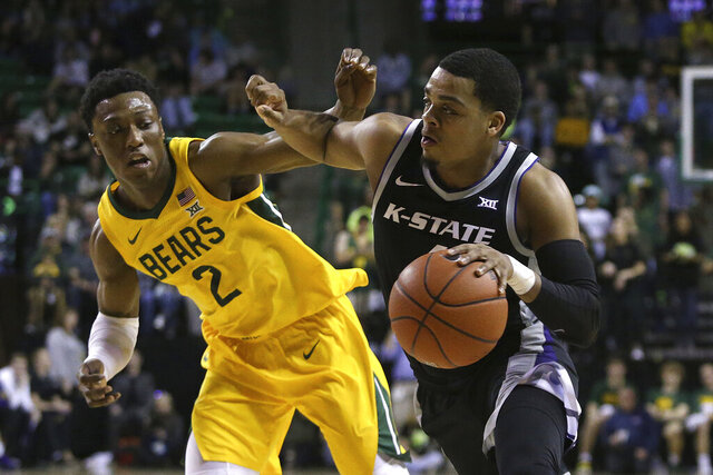 Kansas State guard David Sloan (4) drives the ball against Baylor guard Devonte Bandoo (2) in the first half of an NCAA college basketball game, Tuesday, Feb. 25, 2020, in Waco, Texas. (AP Photo/ Jerry Larson)