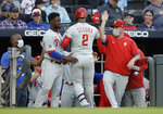 Philadelphia Phillies' Jean Segura (2) is congratulated upon his return to the dugout after hitting a home run off Atlanta Braves pitcher Ian Anderson in the first inning of a baseball game Saturday, May 8, 2021, in Atlanta. (AP Photo/Ben Margot)