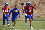 Los Angeles Rams' Matthew Stafford, right, runs a drill while pursued by head coach Sean McVay, center, as John Wolford watches during NFL football practice in Thousand Oaks, Calif., Thursday, May 27, 2021. (AP Photo/Kelvin Kuo)