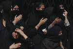 Shiite women beat their chests during a Muharram procession, in Peshawar, Pakistan, Monday, Sept. 9, 2019. Muharram, the first month of the Islamic calendar, is a month of mourning for Shiites in remembrance of the death of Hussein, the grandson of the Prophet Muhammad, at the Battle of Karbala in present-day Iraq in the 7th century. (AP Photo/Muhammad Sajjad) (AP Photo/Muhammad Sajjad)