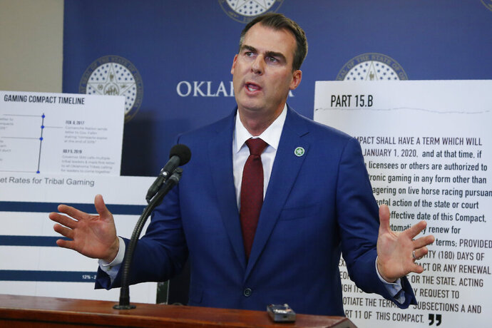 Oklahoma Gov. Kevin Stitt gestures during a news conference concerning the renewal of Tribal Gaming Compacts Thursday, Nov. 14, 2019, in Oklahoma City. (AP Photo/Sue Ogrocki)