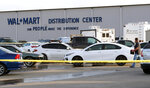 Crime tape blocks off a parking lot outside the Red Bluff Walmart Distribution Center where at least two people were killed, including a shooting suspect and an employee, and four were injured, Saturday, June 27, 2020, in Red Bluff, Calif. (Mike Chapman/The Record Searchlight via AP)