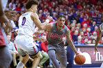 Utah forward Timmy Allen (1) drives on Arizona guard Josh Green during the first half of an NCAA college basketball game Thursday, Jan. 16, 2020, in Tucson, Ariz. (AP Photo/Rick Scuteri)