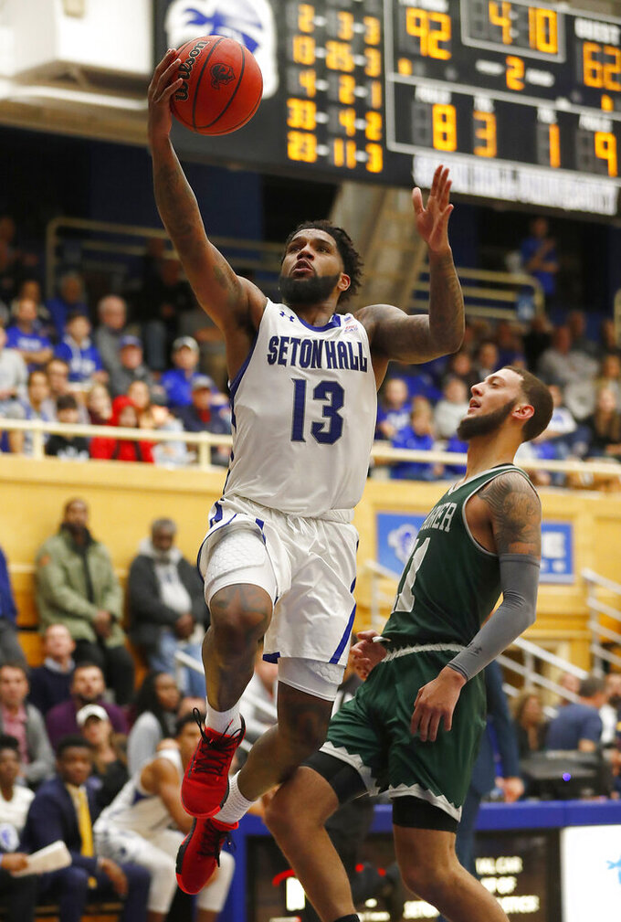 Seton Hall guard Myles Powell (13) goes to the basket against Wagner guard Will Martinez (11) during the second half of an NCAA college basketball game Tuesday, Nov. 5, 2019, in South Orange, N.J. (AP Photo/Noah K. Murray)