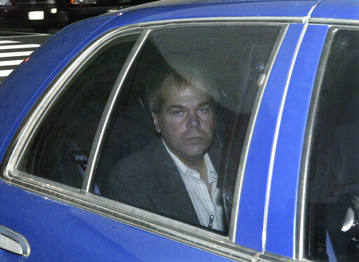 FILE - In this Nov. 18, 2003, file photo, John Hinckley Jr. arrives at U.S. District Court in Washington. Lawyers for Hinckley, the man who tried to assassinate President Ronald Reagan, are scheduled to argue in court Monday, Sept. 27, 2021, that the 66-year-old should be freed from restrictions placed on him after he moved out of a Washington hospital in 2016. (AP Photo/Evan Vucci, File)
