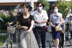 "People wearing masks walk in the Ryomyong street in Pyongyang, North Korea Friday, July 3, 2020. North Korean leader Kim Jong Un urged officials to maintain alertness against the coronavirus, warning that complacency risked ""unimaginable and irretrievable crisis,"" state media said Friday. (AP Photo/Jon Chol Jin)"