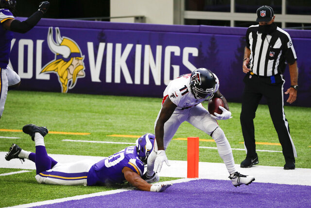 Atlanta Falcons wide receiver Julio Jones (11) breaks a tackle by Minnesota Vikings linebacker Eric Wilson, left, during a 40-yard touchdown reception in the second half of an NFL football game, Sunday, Oct. 18, 2020, in Minneapolis. (AP Photo/Bruce Kluckhohn)