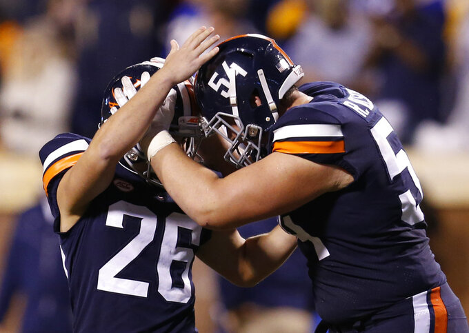 Virginia's Brian Delaney (26) celebrates a field goal with teammate Ryan Nelson (54) during the first half of an NCAA college football game against Pittsburgh in Charlottesville, Va., Friday, Nov. 2, 2018. (AP Photo/Steve Helber)