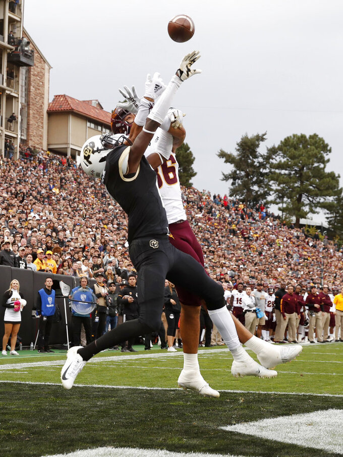 Colorado defensive back Delrick Abrams Jr., front, breaks up a pass intended for Arizona State tight end Ceejhay French-Love in the end zone in the second half of an NCAA college football game Saturday, Oct. 6, 2018, in Boulder, Colo. Colorado won 28-21. (AP Photo/David Zalubowski)