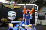 Race driver Scott Dixon, of New Zealand, celebrates after winning the IndyCar auto race at Indianapolis Motor Speedway in Indianapolis, Saturday, July 4, 2020. (AP Photo/Darron Cummings)