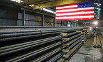 FILE - In this May 9, 2019, photo, steel rods produced at the Gerdau Ameristeel mill in St. Paul, Minn. await shipment. Last week's flareup over the Mexico tariffs may prove to be a pivotal juncture. The spat was especially alarming to businesses because it came seemingly out of nowhere. Less than two weeks earlier, President Donald Trump had lifted tariffs on Mexican and Canadian steel and aluminum, action that seemed to signal warmer commercial ties between the United States and its neighbors. (AP Photo/Jim Mone, File)