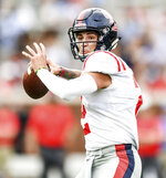 Mississippi quarterback Matt Corral (2) passes during the Grove Bowl spring NCAA college football game at Vaught-Hemingway Stadium in Oxford, Miss., Saturday, April 6, 2019. (Bruce Newman/The Oxford Eagle via AP)