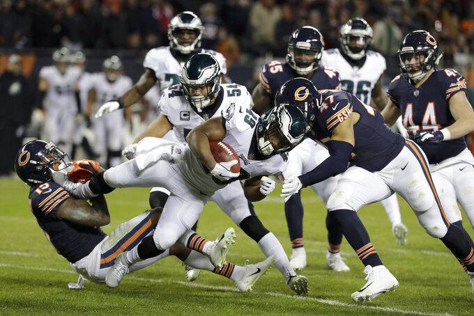 Philadelphia Eagles' Boston Scott (49) is tackled by Chicago Bears' Josh Bellamy (15) and Isaiah Irving (47) on a kick off return during the second half of an NFL wild-card playoff football game Sunday, Jan. 6, 2019, in Chicago. (AP Photo/Nam Y. Huh)