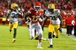 Kansas City Chiefs wide receiver Mecole Hardman (17) runs for a touchdown between Green Bay Packers cornerback Tramon Williams (38) and safety Adrian Amos (31) during the first half of an NFL football game in Kansas City, Mo., Sunday, Oct. 27, 2019. (AP Photo/Ed Zurga)