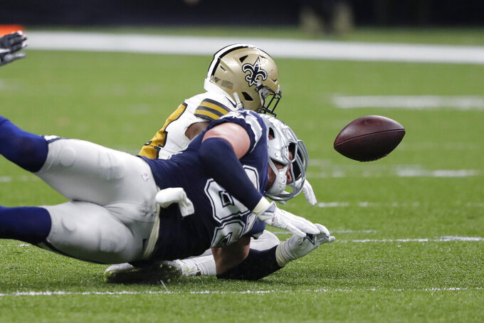 Dallas Cowboys tight end Jason Witten fumbles against New Orleans Saints strong safety Vonn Bell in the first half of an NFL football game in New Orleans, Sunday, Sept. 29, 2019. (AP Photo/Bill Feig)