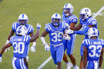 Duke cornerback Jeremiah Lewis (39) celebrates with teammates after he intercepted a pass against the Virginia Tech during the first half of an NCAA college football game, Saturday, Oct. 3, 2020, in Durham, N.C.  (Nell Redmond/Pool Photo via AP)