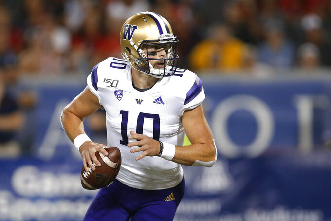 Washington quarterback Jacob Eason looks for a receiver during the first half of the team's NCAA college football game against Arizona on Saturday, Oct. 12, 2019, in Tucson, Ariz. (AP Photo/Rick Scuteri)
