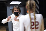 Stanford head coach Tara VanDerveer talks with her players during a time-out against Cal Poly in the second half of an NCAA college basketball game in Stanford, Calif., Wednesday, Nov. 25, 2020. (AP Photo/Tony Avelar)
