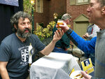 In this March 9, 2019 photo, Jamie Adams, left, hands out a sample of his new ale called