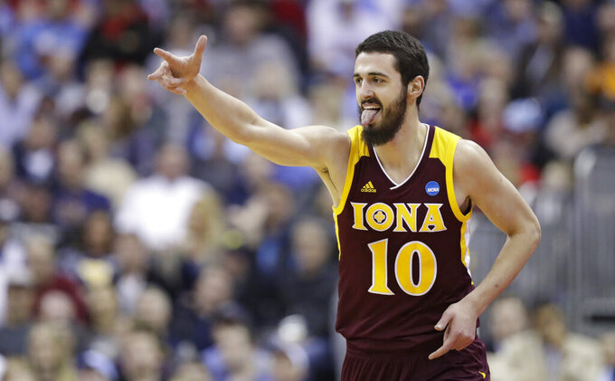 Iona's Andrija Ristanovic reacts after hitting a three-point basket in the first half against North Carolina during a first round men's college basketball game in the NCAA Tournament in Columbus, Ohio, Friday, March 22, 2019. (AP Photo/Tony Dejak)