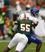 FILE - In this Sept. 8, 2018, file photo, Miami linebacker Shaquille Quarterman (55) sacks Savannah State quarterback D'Vonn Gibbons (3) during the first half an NCAA college football game, in Miami Gardens, Fla. Miami's defense  led the nation in third-down stops last season. (AP Photo/Brynn Anderson, File)