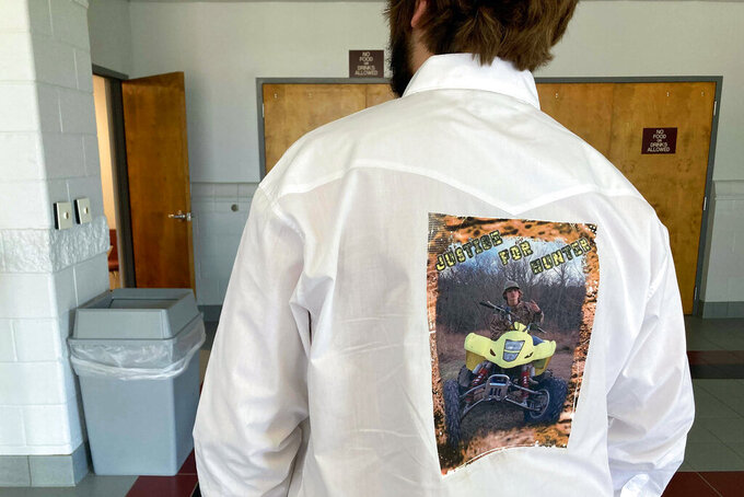 Andrew Mone wears a shirt featuring Hunter Brittain before a memorial service in Beebe, Ark., on Tuesday, July 6, 2021. Brittain, 17, was shot and killed by a Lonoke County Sheriff's deputy during a traffic stop on June 23. (AP Photo/Andrew Demillo)
