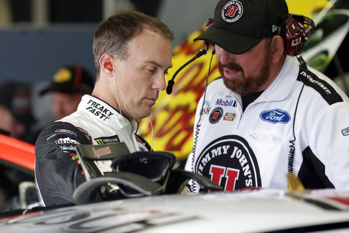 Kevin Harvick, left, prepares to practice for Sunday's NASCAR Cup Series auto race at Charlotte Motor Speedway in Concord, N.C., Saturday, Sept. 28, 2019. (AP Photo/Gerry Broome)