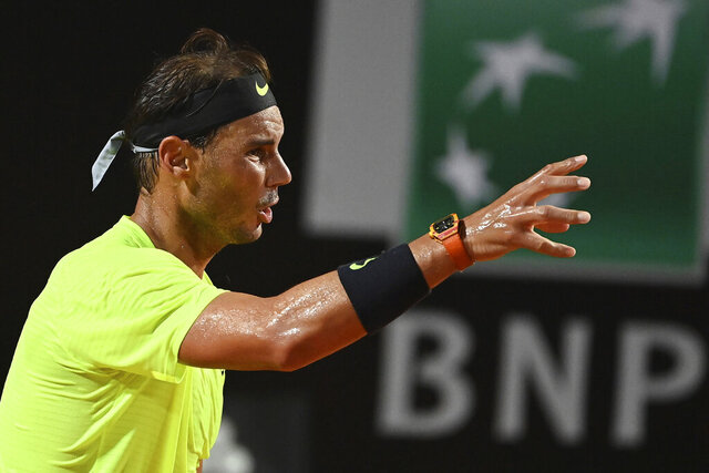 Spain's Rafael Nadal gestures as he competes with Argentina's Diego Schwartzman during their quarterfinals at the Italian Open tennis tournament, in Rome, Saturday, Sept. 19, 2020. (Alfredo Falcone/LaPresse via AP)