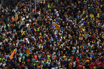 Protesters pack the street on the fifth day of protests over the conviction of a dozen Catalan independence leaders in Barcelona, Spain, Friday, Oct. 18, 2019. Tens of thousands of flag-waving demonstrators demanding Catalonia's independence and the release from prison of their separatist leaders have flooded downtown Barcelona. The protesters have poured into the city after some of them walked for three days in