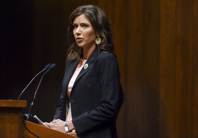 FILE - In this April 13, 2020, file photo, Gov. Kristi Noem speaks at the Sanford Center in Sioux Falls, S.D. Noem appeared headed Monday, May 11, 2020, for a legal confrontation with two Native American Indian tribes over highway checkpoints intended to keep the coronavirus away from their reservations. The issue pits a governor who has taken a mostly hands-off approach to restrictions during the pandemic against tribes who say her actions are inadequate to prevent infections. (Abigail Dollins/Argus Leader via AP, File)