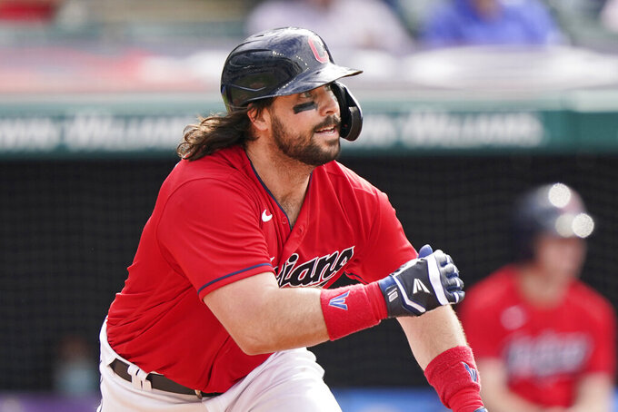 Cleveland Indians' Austin Hedges watches his RBI-single in the second inning of a baseball game against the Minnesota Twins, Saturday, May 22, 2021, in Cleveland. (AP Photo/Tony Dejak)