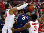 Illinois guard Ayo Dosunmu, center, works against Ohio State forward Kaleb Wesson, left, and guard C.J. Jackson during the first half of an NCAA college basketball game in Columbus, Ohio, Thursday, Feb. 14, 2019. (AP Photo/Paul Vernon)